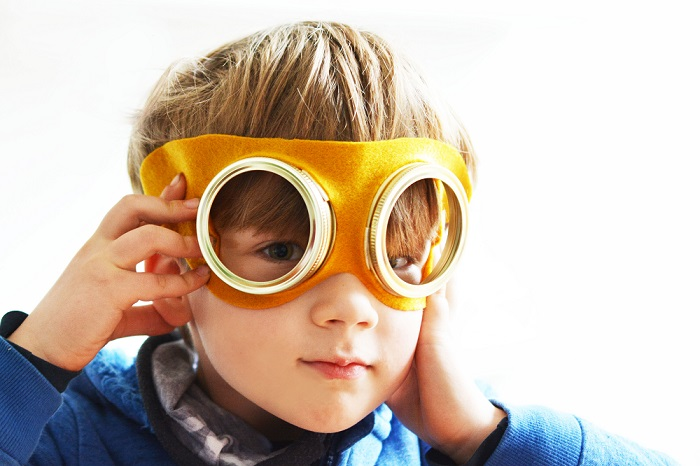 A child with the flying goggles that they have created