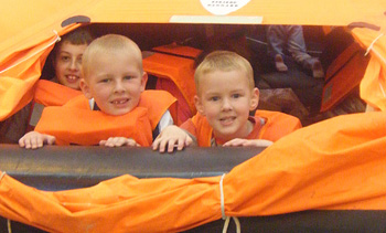 Two young visitors inside a RAF life raft