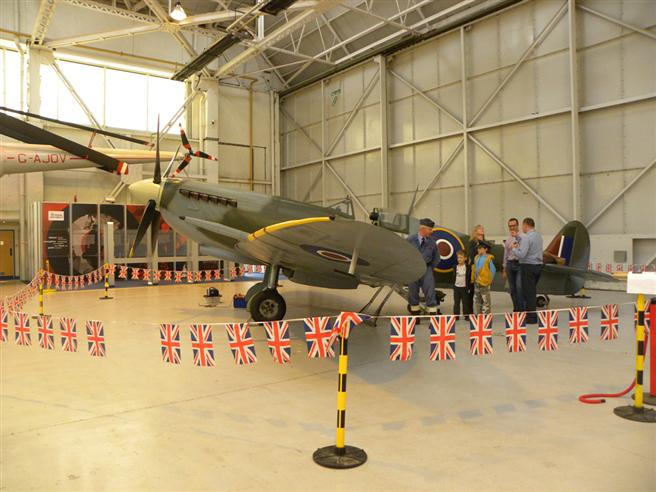 Visitors examining a replica Spitfire up close and personal.