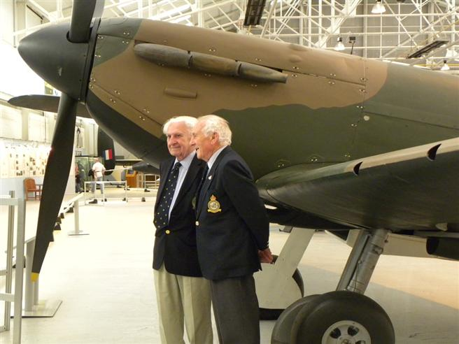 2 veterans of the Battle of Britain campaign, standing next to the world's oldest surviving Spitfire.