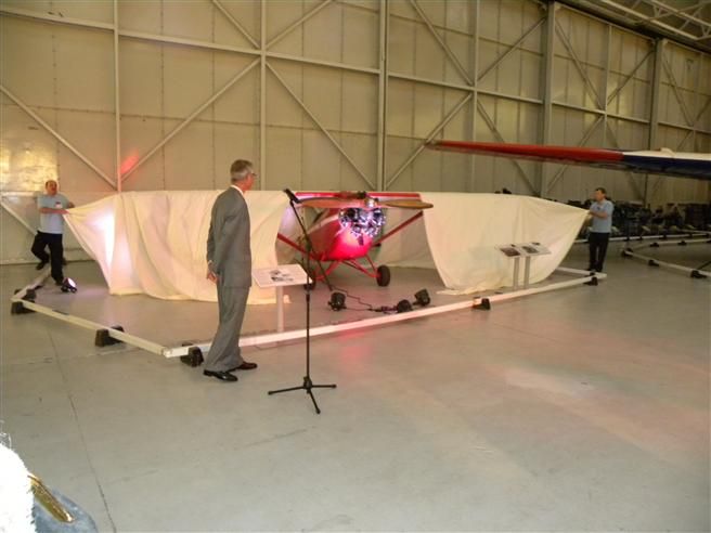 Alex Henshaw Junior unveils the Comper Swift aircraft in which his father flew.