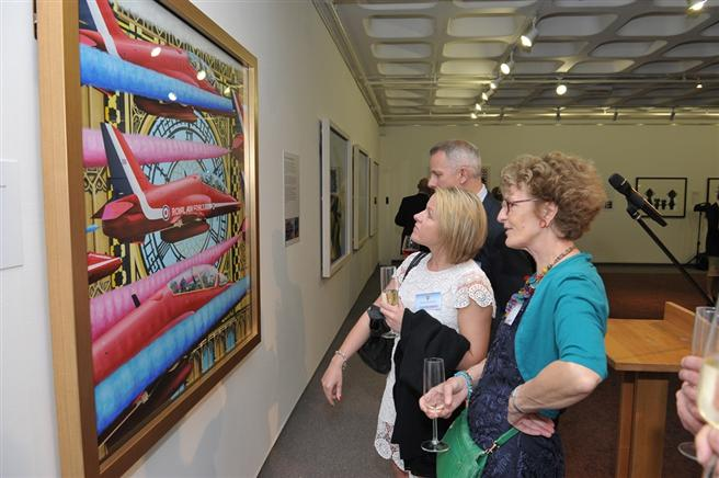 Guests viewing 'Timeless' one of the compositions on display.