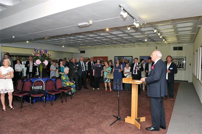 Sir John Day, Chairman of the Trustees, opening the exhibition with assembled guests.