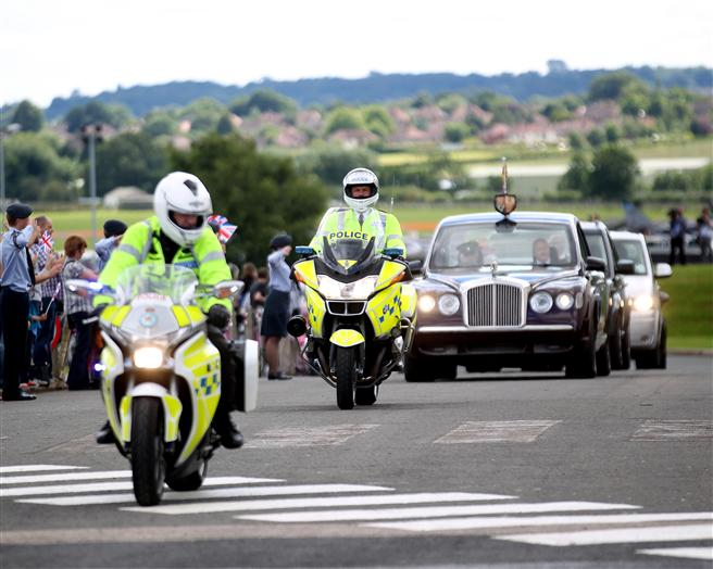 Police escort for the Queen's arrival at the Museum