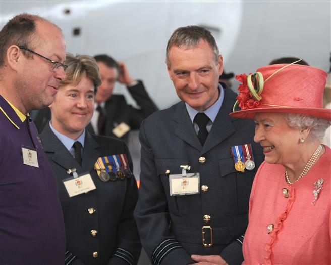 The Queen meets with some of the event organisers