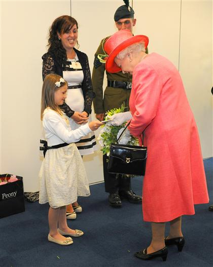 Jessica Jones aged 8 presents the Queen with a posy.
