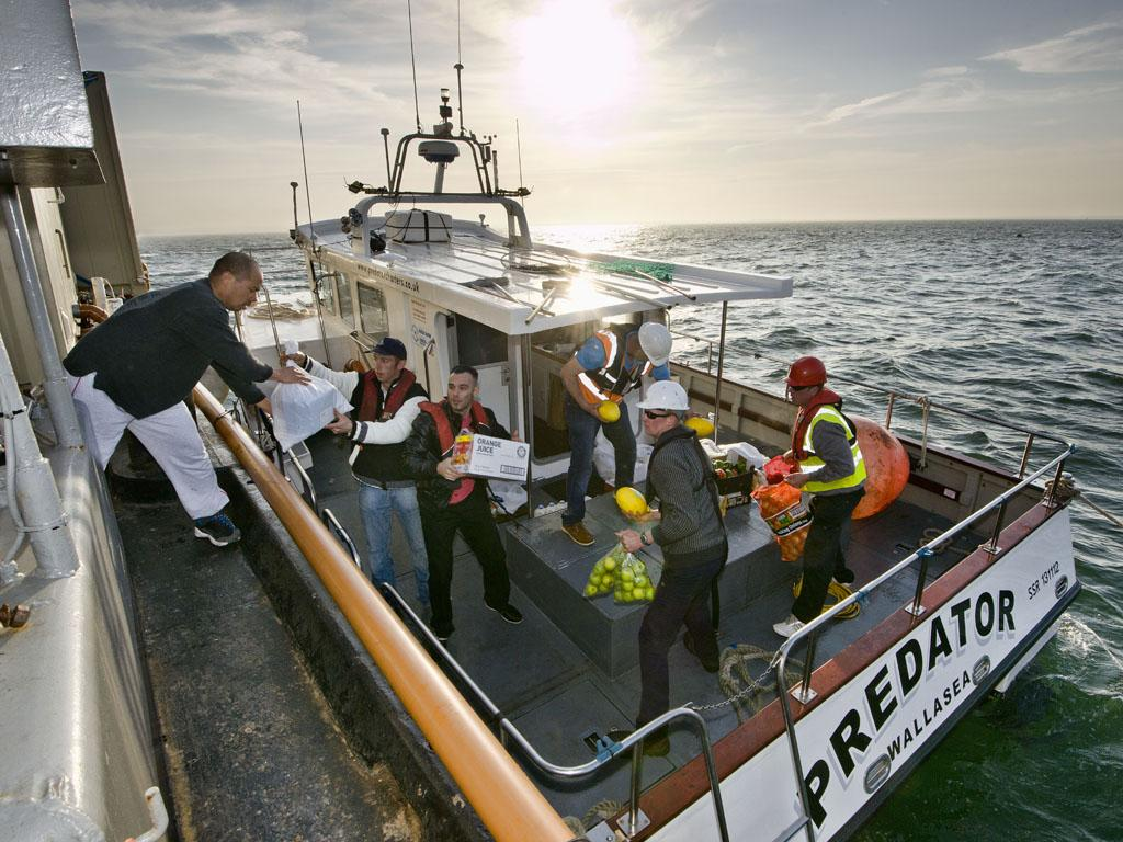 A busy crew is a hungry crew- the Predator is the barge's daily link with land.