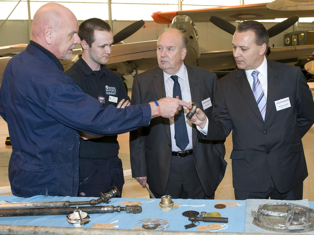 Mick and Dave showing guests smaller components recovered from the aircraft