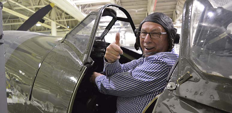 Ken Bruce sitting in our Spitfire Mk16