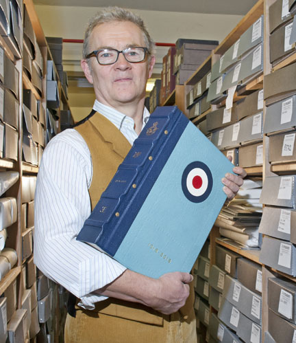 Martin Morgans with a copy of the RAF 100 Anthology