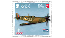 An Isle of Man RAF Centenary commemorative stamp, showing a Spitfire in Flight