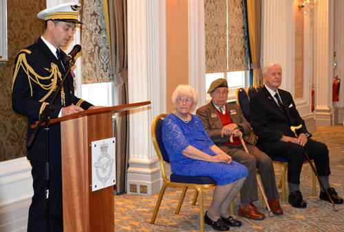 From left to right :  Colonel Murand, Air Attaché French Embassy (speaking) Leading Aircraft Woman, Rose Davies, Lance Bombardier Arthur Jones, & Battle of Britain Pilot Wing Commander Tom Neil