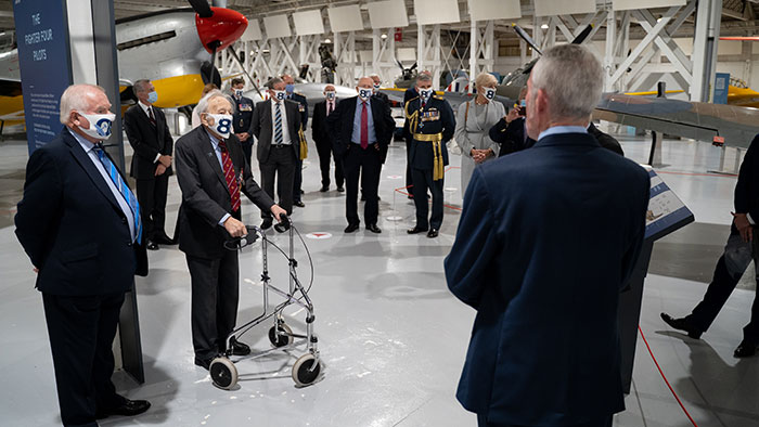 Honoured Guests being given a tour of London's Battle of Britain displays by Ian Thirsk the Museum's Head of Collections
