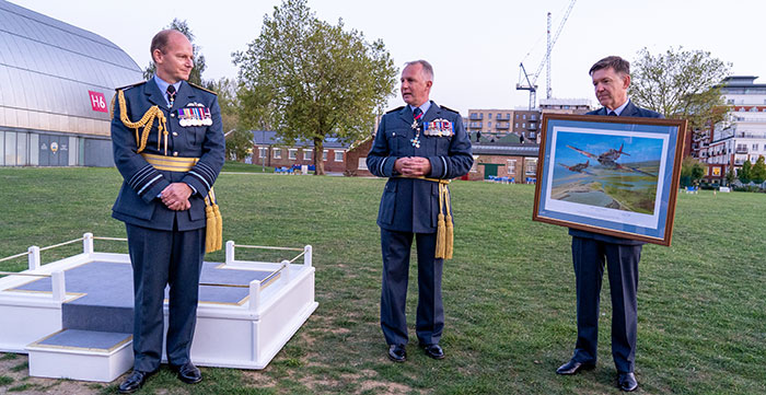 Malcolm Brecht CB CBE Officer Commanding 601 (County of London) Sqn RAuxAF (centre) and Wg Cdr John Chappell MBE 601 (County of London) Sqn RAuxAF (right) presenting CAS (left) with a painting of 601 Squadron in an engagement during the Battle of Britain