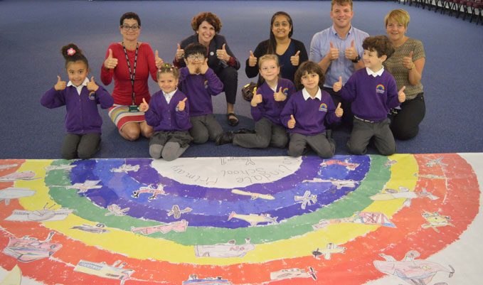 Maggie Appleton (CEO of the Museum, top row second left) with the staff and students of Colindale Primary School