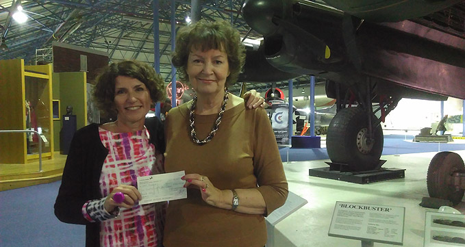 Maggie Appleton Museum CEO receiving a cheque from Vivienne Hammer, Bomber Command Association's Registrar