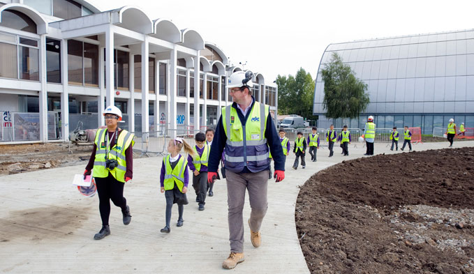 Mick Bunday, Assistant Site Manager of SDC, with teacher and children with Colindale Primary School
