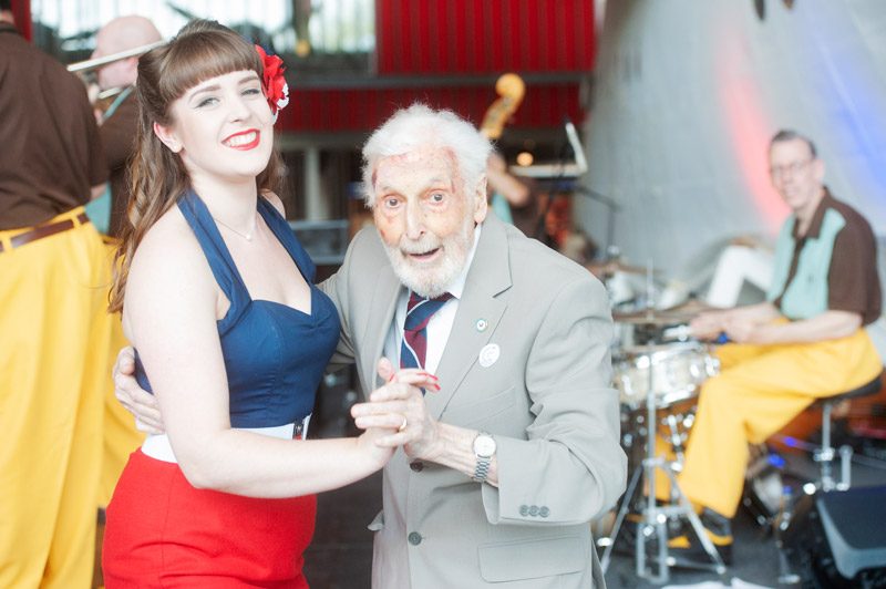 A Veteran Dancing with one of the members of the Jive Aces Band