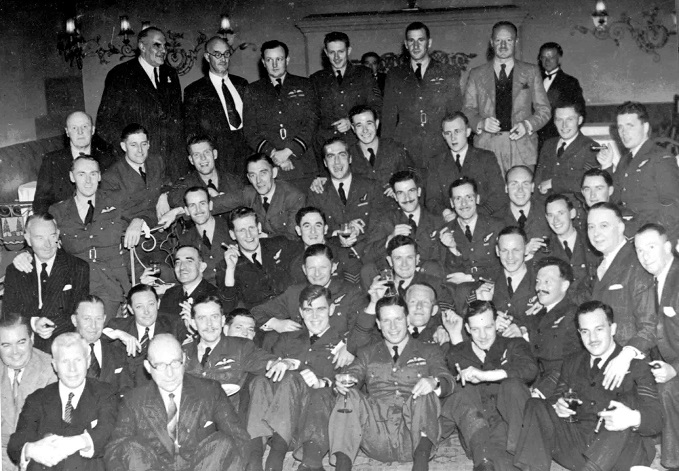 Group Photograph of 617 Sqn at a party with Barnes Wallis and Guy Gibson in foreground, 22 June 1943. © Barry Swaebe, Barry Swaebe Archive