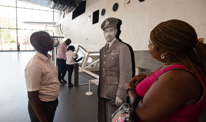 Visitors admiring Flying Officer Wassoudewa's silhouette while some of their party use the Kiosk