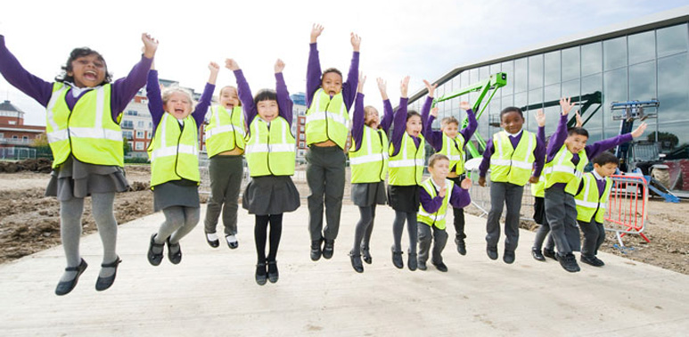 Children from a local school receiving a tour of our new site