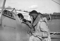 Student pilot receiving final instructions before first solo, 1938