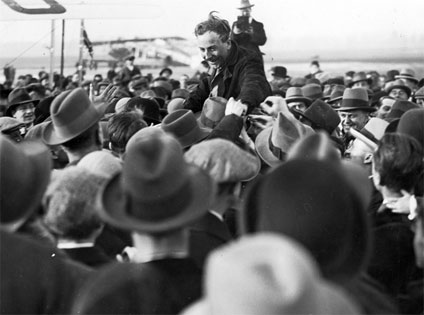 Alan Cobham being congratulated by the crowd that had assembled at Croydon Aerodrome, London after the successful completion of his South Africa Flight