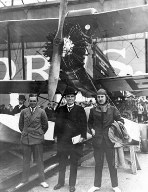 (From left to right) Arthur Elliott, Sir Charles Wakefield and Alan Cobham in front of a de Havilland D.H.50J biplane with specially constructed floats at Rochester, England
