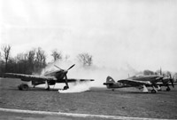 Many expected that the Germans would use gas. Constant training took place as here where smoke bombs envelop Hawker Hurricane Mark Is of 'B' Flight, No. 87 Squadron RAF, in their dispersal at Lille-Seclin during a practice gas attack. © AHB