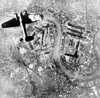 A Heinkel He 111 bomber flying over London's docks.