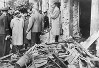 German Propaganda Minister Joseph Goebbels inspects a bomb damaged street in Berlin