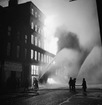 Buildings burning in Manchester after a German air raid