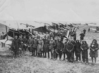 Pilots and ground crew of No. 32 Squadron with their S.E.5a aircraft, France, 1918