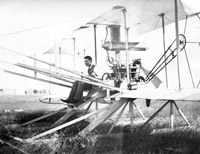 Frank McLean seated in Short Biplane No. 1 before a flight attempt, 1909