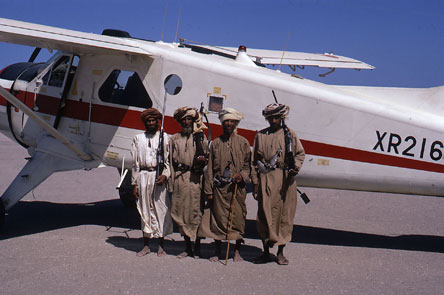 Local tribesmen guarding a De Havilland DHC-2 Beaver of the Sultan of Oman's Air Force