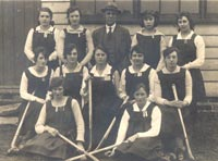 Amy, aged about 18, with her school hockey team