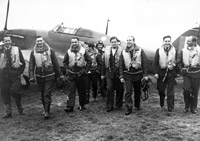 Pilots of 303 (Polish) Squadron walking away from a Hurricane