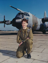 Flight Lieutenant Julie Gibson with a Lockheed Hercules